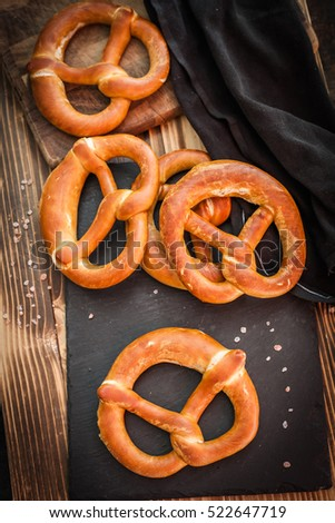 Soft homemade pretzels on a stone cutting board