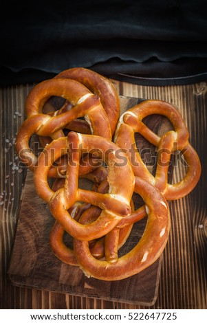 Soft homemade salted pretzels on wooden table