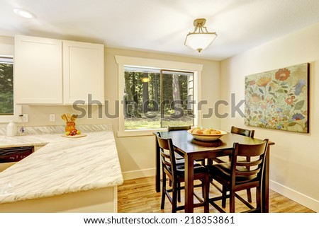 Soft ivory dining area in bright kitchen room