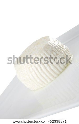 soft light round cheese on cutting plate