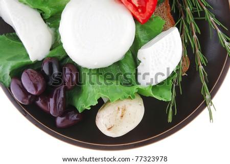 soft mozzarella served with bread on dark plate - stock photo