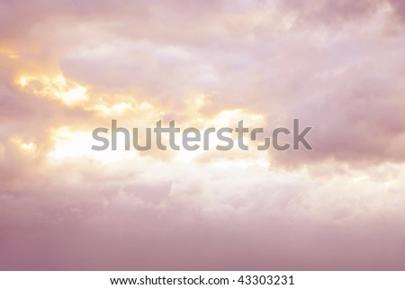 Soft pastel colors in a beautiful sky. - stock photo