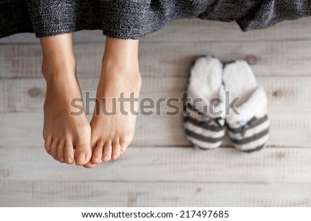 Soft photo of woman feet with slippers, top view point - stock photo