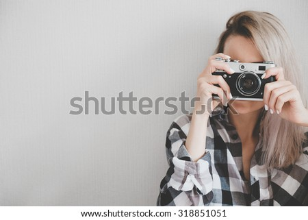Soft photo of woman in checkered shirt making a picture - stock photo