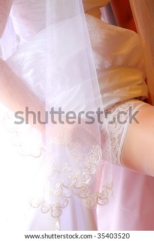 Soft Pink and white lace bridal garter - stock photo