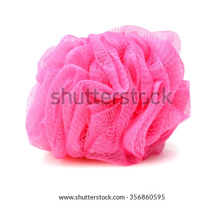 Soft pink bath puff or sponge isolated on white background with copy space.  - stock photo