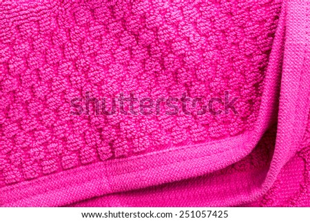 Soft pink texture of bath towel folded with blank space - stock photo