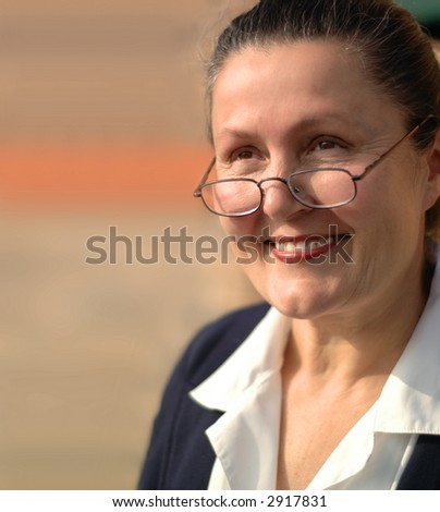 Soft portrait of an older elegantly dressed career woman - stock photo