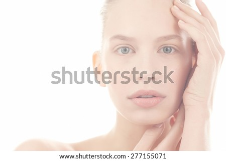 Soft portrait of young woman on white background
