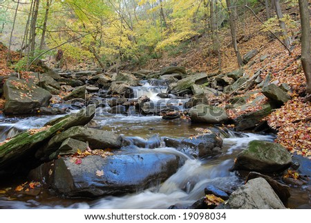 soft rapids on autumn river - stock photo
