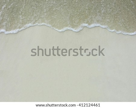 Soft sand and ocean tide in the Maldives - stock photo