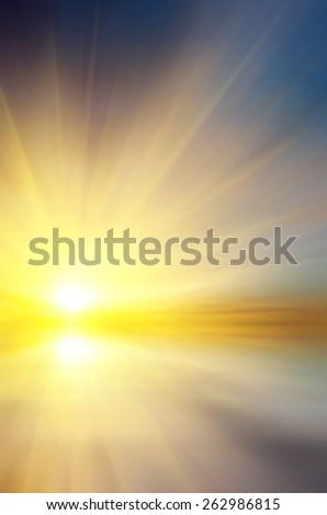 Soft sunset over the sea. The sun sets over the horizon. Abstract composition - stock photo
