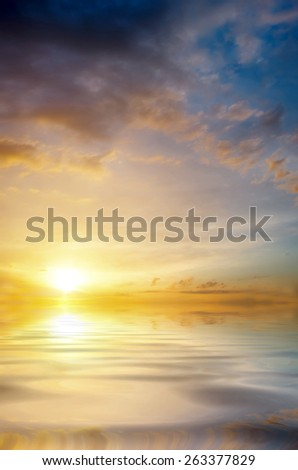 Soft sunset over the sea. The sun sets over the horizon. romantic composition - stock photo