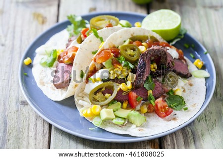 Soft tacos with fillet steak, sweetcorn, coleslaw, avocado and tomato salsa