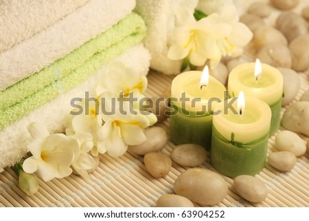 soft towels, burning candles and white stones - stock photo