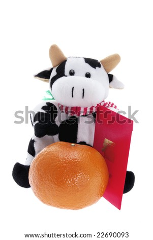 Soft Toy Cow and Mandarin on White Background