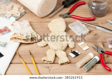 Soft Toy Creation Process. Teddy Style Bear. Sewing Accessories. Fur Patches. Wooden Table.