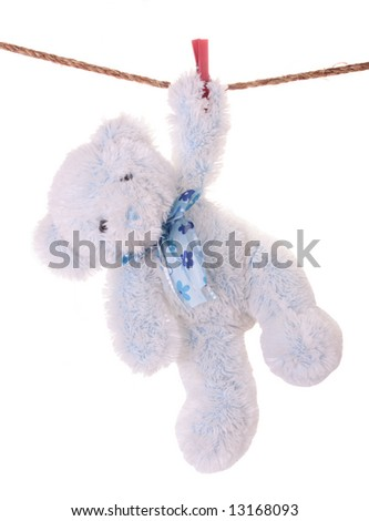 Soft toy drying on the linen cord