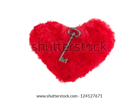 Soft toy in the form of heart with a key. Gift for Valentine's Day. Isolation.