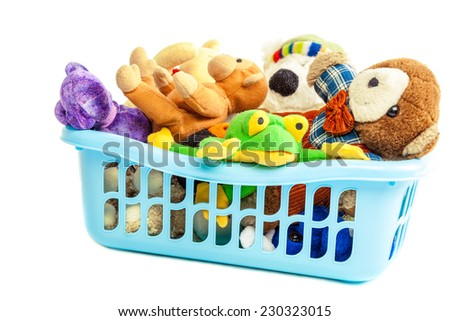 Soft toys in a plastic container isolated on white background. - stock photo