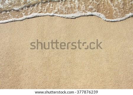 Soft wave of sea on sandy beach. Background. - stock photo