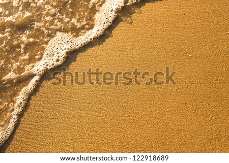 Soft wave of the sea, beach sand texture. - stock photo