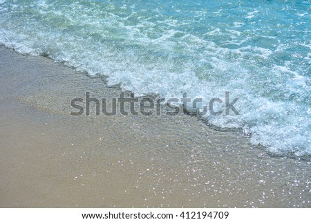 Soft wave of the sea on the sandy beach. Natural summer background with copy space - stock photo