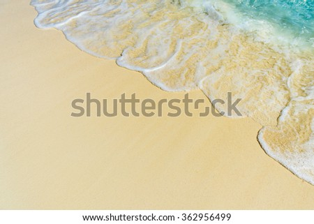 Soft wave of the sea on the tropical sandy beach - stock photo