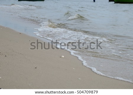 Soft waves and sandy beach. Small wave and sandy beach