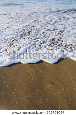 Soft waves on the beach