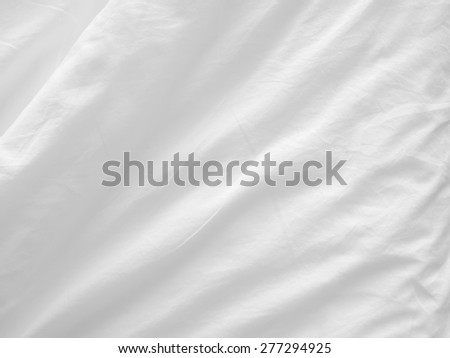 soft white bed sheets background - stock photo
