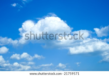 Soft white clouds against blue sky - stock photo