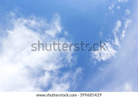 Soft white clouds against blue sky background - stock photo