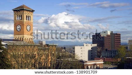 Soft white clouds surround the old City Hall Building and the Tacoma Washington skyline Mt. Rainier obscured, United States - stock photo