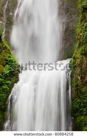 Soft white Frothy Water Falls with one into another - stock photo