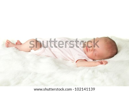 Soft white furry blanket with an newborn baby of 18 days old