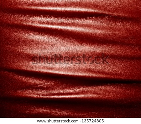 Soft wrinkled red leather. Texture or background with copyspace, high resolution - stock photo