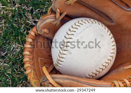 softball in glove - stock photo