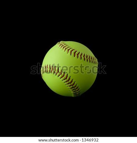 Softball isolated on black - stock photo