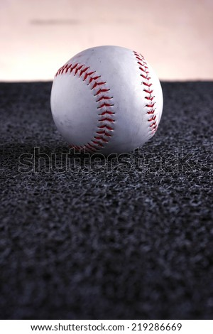 Softball Photo of a softball on a gray mat