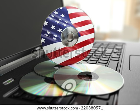 Software made in USA CD on laptop keyboard. Compact disks. 3d - stock photo