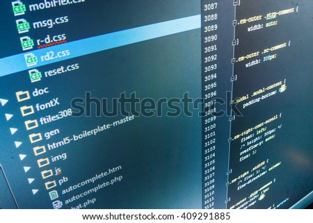 Software source code.  Website codes on computer monitor. Computer script.  Programming code. Developer working on software codes in office. Software background. Writing program code on computer.   - stock photo