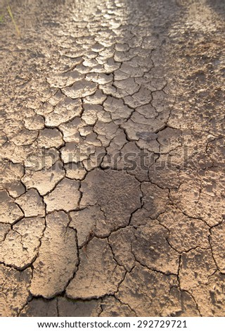 Soil cracks desert sands water evaporation stagnation and global warming large cracks in clay soil due to water evaporation - stock photo