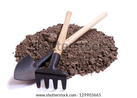 Soil for seedling and decorative tools on a white background - stock photo