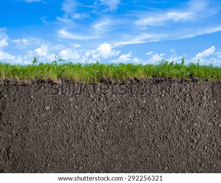 Soil, grass and sky nature background - stock photo