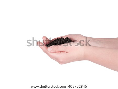 soil in female hands on a white background