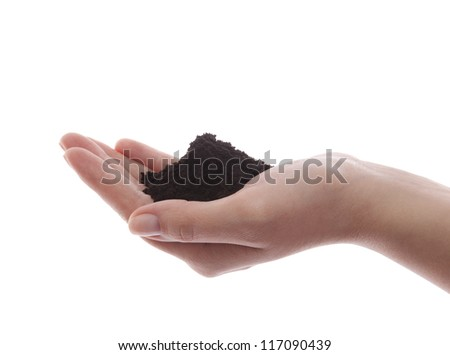 Soil in hand with clipping path - stock photo