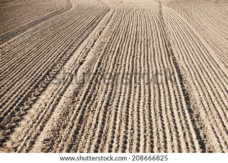 soil of an agricultural field in spring time - stock photo