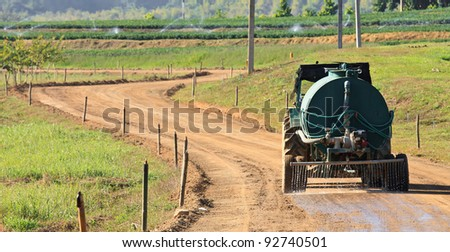Soil road in countryside - stock photo