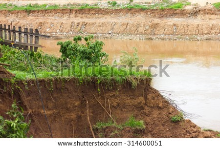 Soil slides down the coast collapsed because of the water flowing in the river eroded a long time. - stock photo